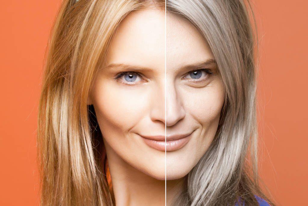 Frau mit blonden und grauen Haaren.